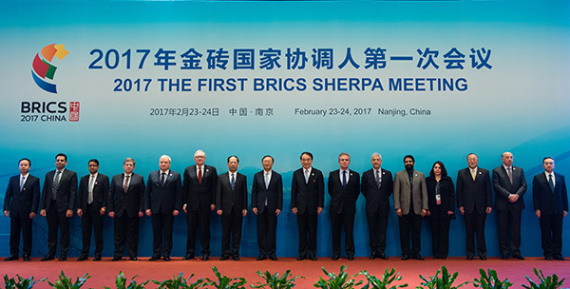 State Councilor Yang Jiechi (eighth from left) and representatives of BRICS countries pose on Thursday at the opening ceremony of the year's first BRICS Sherpa meeting in Nanjing, Jiangsu province. Yang urged BRICS nations to work together to raise the voices of developing countries in global affairs. (Xinhua/Li Xiang)